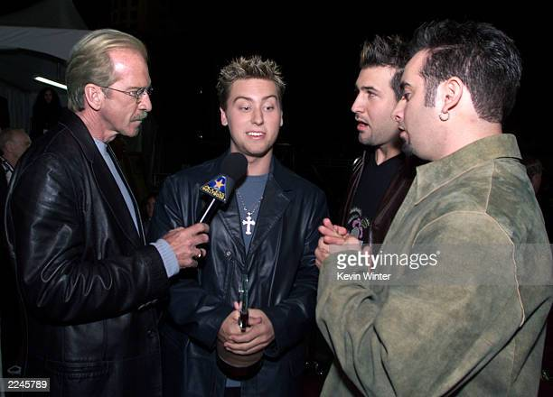 Access Hollywood host Pat O'Brien interviews 'N SYNC members Lance Bass second from left Joey Fatone center and Chris Kirkpatrick right after the...