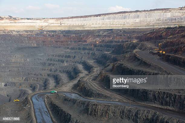 Access roads for trucks line the open pit of the Stoilensky GOK iron ore mine and processing plant operated by OAO Novolipetsk Steel also known as...