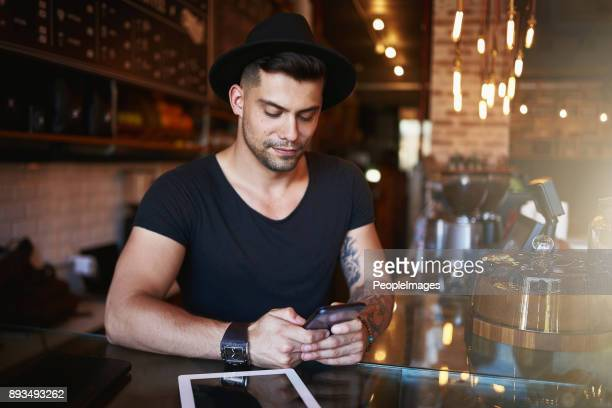Accessing the best cafe management apps right from his phone