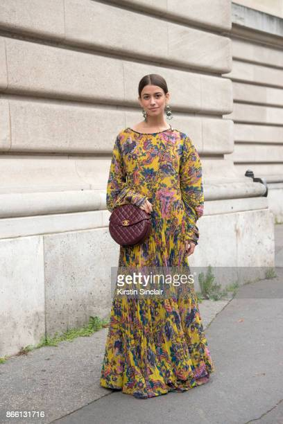 Accessories Director at Harper's Bazaar Amanda Alagem wears an Etro dress and a Chanel bagn day 2 of Paris Womens Fashion Week Spring/Summer 2018 on...