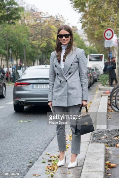 Accessories Director at Harper's Bazaar US Amanda Alagem wears an Isabel Marant suit Balenciaga bag Celine sunglasses and Alexandre Birman shoes day...