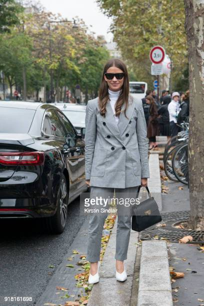 Accessories Director at Harper's Bazaar US Amanda Alagem wears an Isabel Marant suit Balenciaga bag Celine sunglasses and Alexandre Birman shoes day...