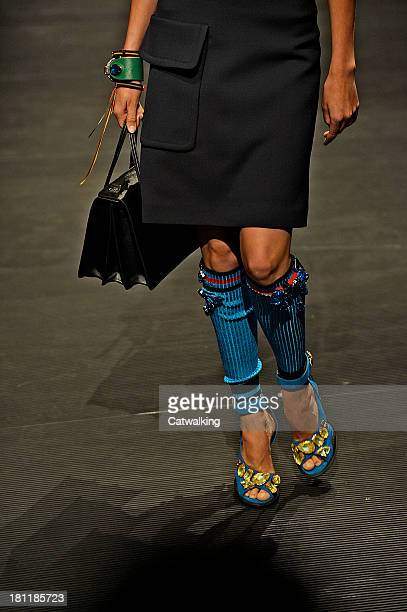 Accessories show detail on the runway at the Prada Spring Summer 2014 fashion show during Milan Fashion Week on September 19 2013 in Milan Italy