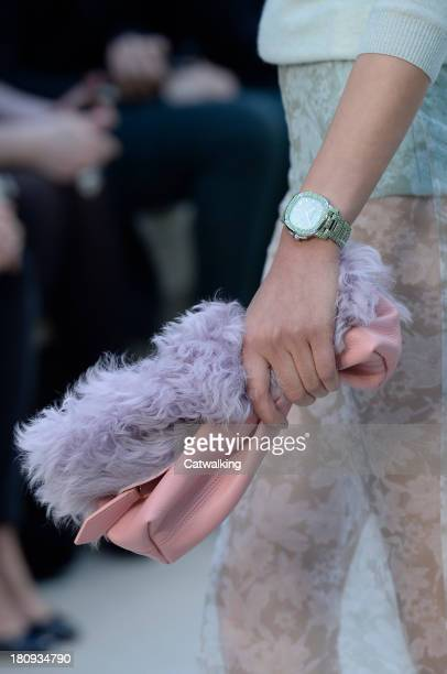 Accessories watch and bag detail on the runway at the Burberry Prorsum Spring Summer 2014 fashion show during London Fashion Week on September 16,...