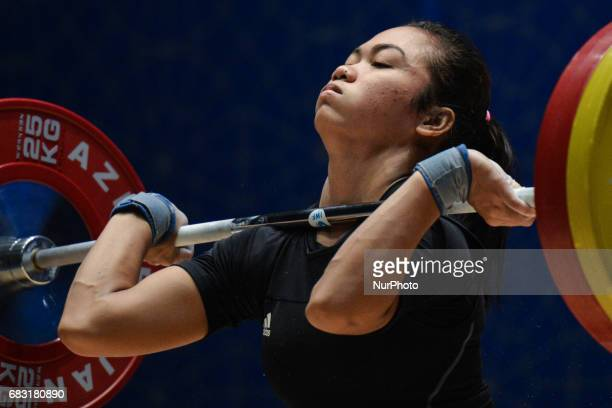 Acchedya Jagaddhita of Indonesia competes in Women's 58kg Weightlifting final during day three of Baku 2017 4th Islamic Solidarity Games at...