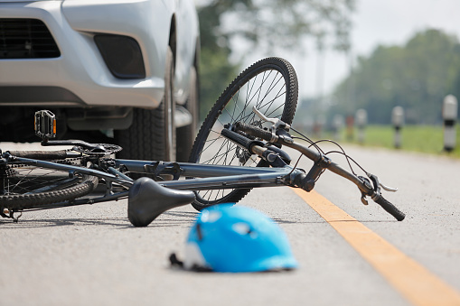 Accident car crash with bicycle on road 864998022