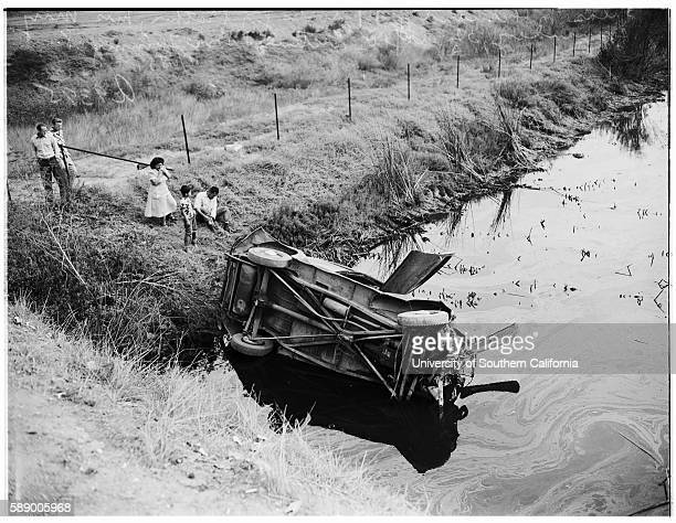 Accident car in slough at 198th Street and Main Street Howard Wilkes who found the car Silas M Hernandez looks for his brother's body in slough Mrs...