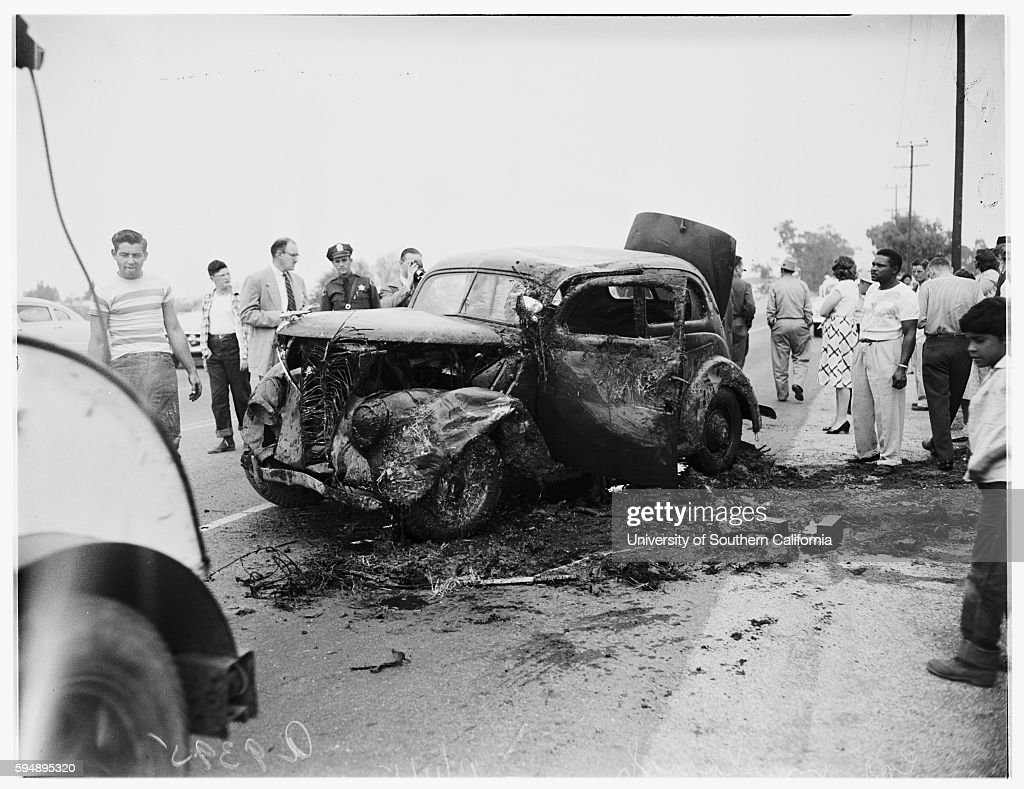 Accident... car in slough at 198th Street and Main Street, 1951 : News Photo