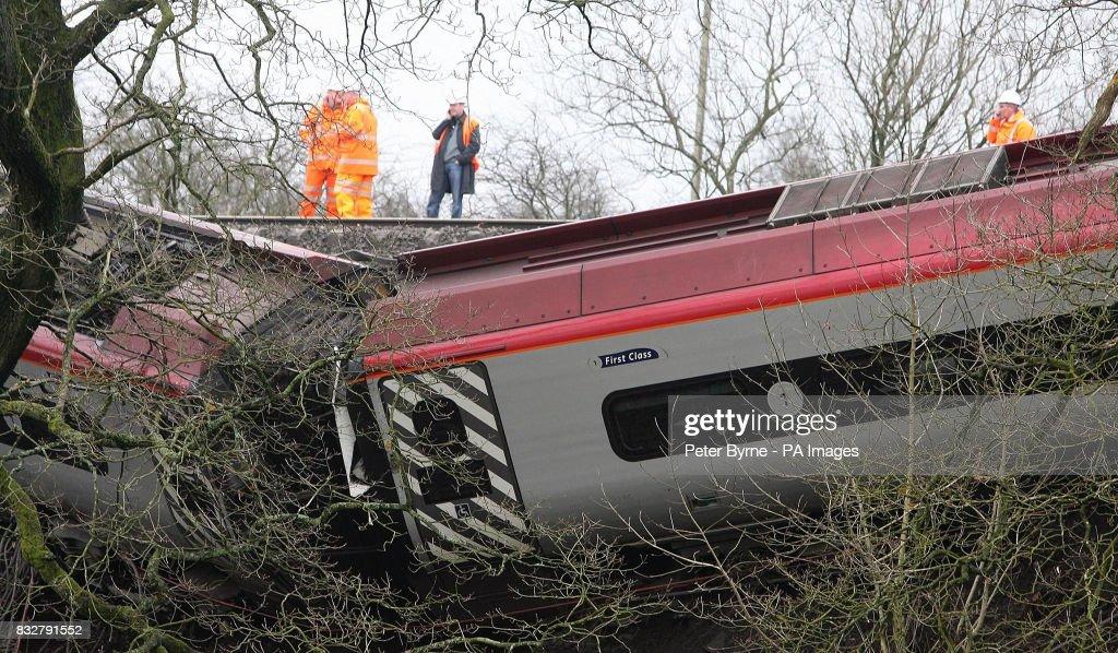 Accident investigators overlook the wreckage of the Virgin Pendolino