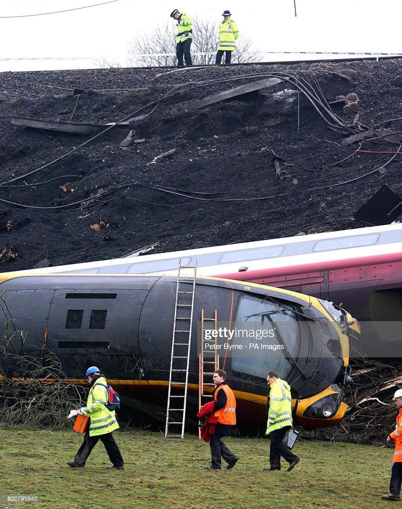 Accident investigators search the wreckage of the Virgin Pendolino
