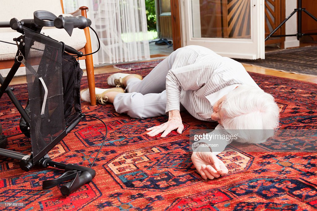 accident senior woman after fall lying on ground : Stock Photo
