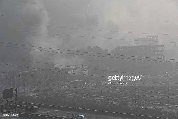 Accident site is still smoking after explosions of a warehouse on late Wednesday in Binhai New Area on August 13 2015 in Tianjin China At least 17...
