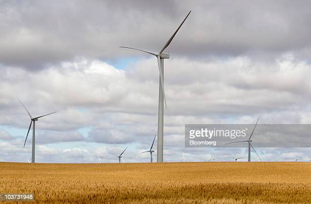 Acciona wind turbines sit next to wheat fields at the NaturEner USA LLC Glacier wind energy farm in Ethridge Montana US on Monday Aug 30 2010 Acciona...