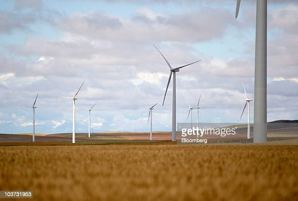 Acciona wind turbines sit next to wheat fields at the NaturEner USA LLC Glacier wind energy farm in Ethridge Montana US on Monday Aug 30 2010 Acciona...