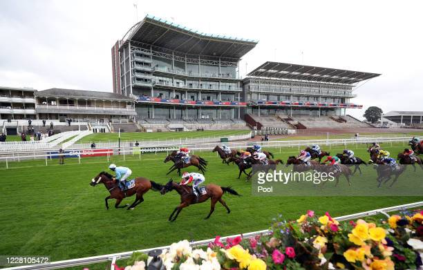 Acclaim The Nation ridden by jockey Jason Hart wins the Sky Bet And Symphony Group Handicap during day one of the Yorkshire Ebor Festival at York...
