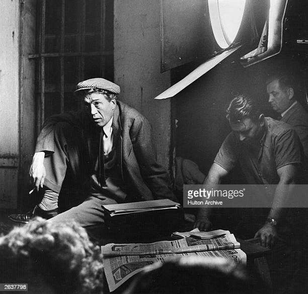 Acclaimed director John Huston watches the technicians at work during filming of 'Moulin Rouge' his fictional biopic of artist Toulouse Lautrec