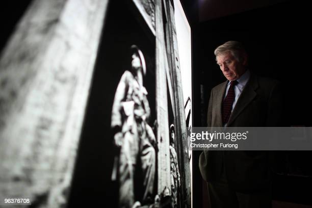 Acclaimed photographer Don McCullin poses next to one of his legendary images at the Imperial War Museum North Manchester on February 3 2010 in...