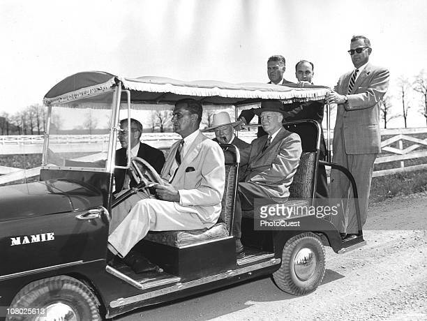 Accompanied by a number of aides and secret service men, British former Prime Minister Winston Churchill rides with US President Dwight Eisenhower in...