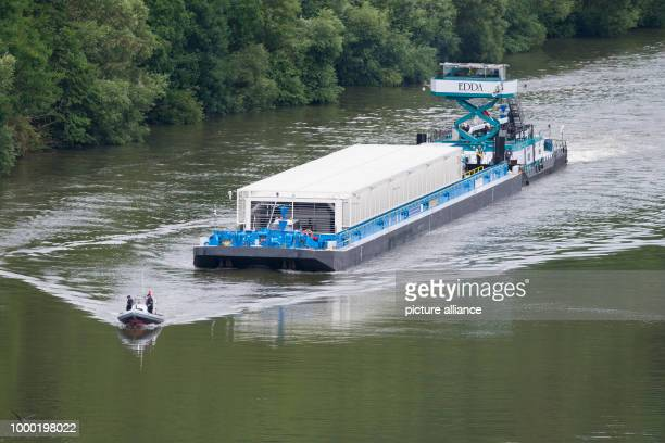 Accompanied by a police boat the push boath 'Edda' pushes the transport ship loaded with three Castor containers on the Neckar river near Bad Wimpen...