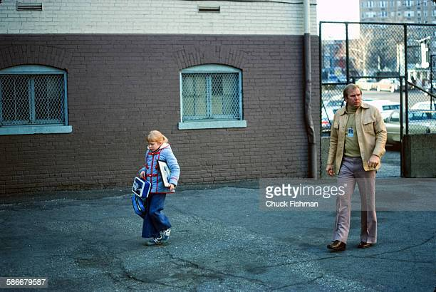 Accompanied by a Secret Service agent American First Daughter Amy Carter walks across a schoolyard on her way to class Washington DC late 1970s She...