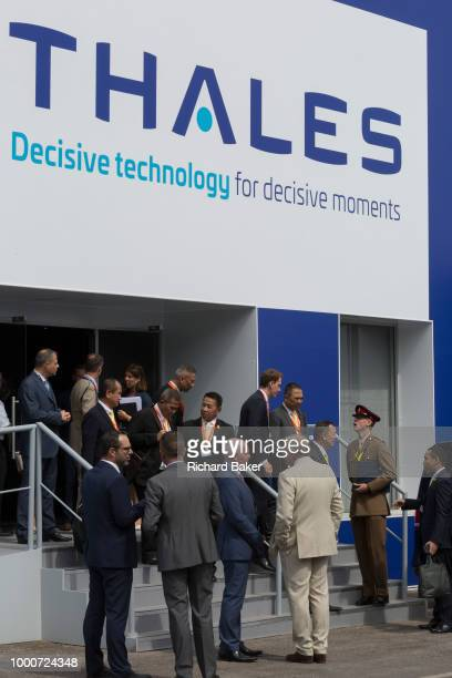 Accompanied by British military personnel potential customers leave the Thales exhibition and hospitality chalet at the Farnborough Airshow on 16th...