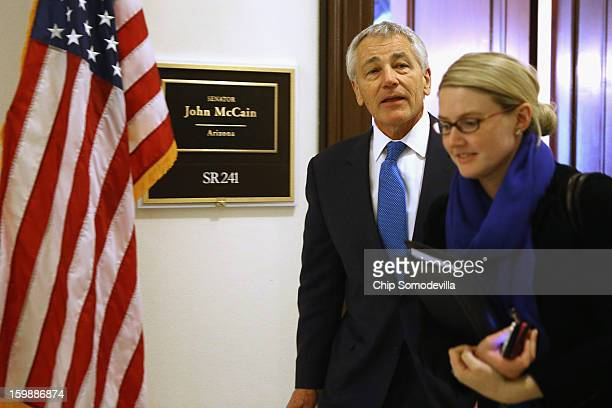 Accompanied by CIA Spokesperson Marie Harf former US Senator Chuck Hagel leaves the Capitol Hill offices of Sen John McCain after the two Vietnam War...