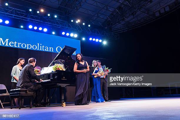 Accompanied by Dan Saunders on piano American soprano Janai Brugger joined by mezzosoprano Isabel Leonard and baritone Nathan Gunn performs during an...