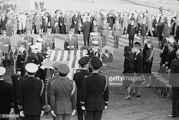 Accompanied by her brother-in-law, U.S. Attorney General Robert Francis Kennedy, Mrs. Jacqueline Kennedy stands at the flag-covered coffin of her...