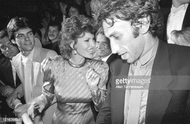 Accompanied by her son Damon and her husband Andre Weinfeld right American actress Raquel Welch arrives at a party New York New York June 29 1982 The...