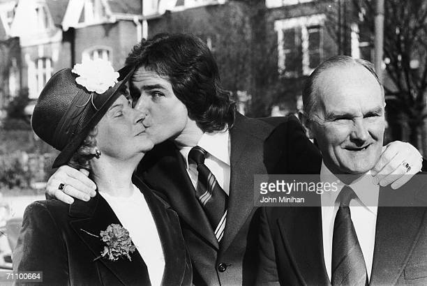 Accompanied by his parents Frank and Iris, world motorcycle champion Barry Sheene leaves home to accept his OBE at Buckingham Palace, 7th March 1978.