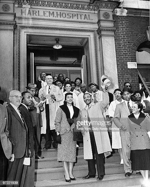 Accompanied by his wife Coretta Scott King the Reverend Martin Luther King Jr leaves Harlem Hospital The 29yearold clergyman and fighter for...