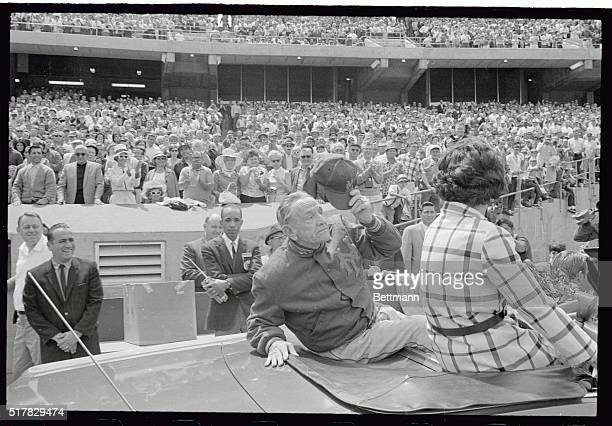 accompanied by his wife Edna Casey Stengel doffs his hat to a standing ovation from the audience as he arrived at the coliseum in an open car Stengel...
