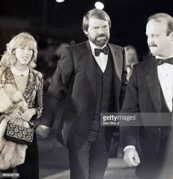 Accompanied by his wife Kimberly Woollen American musician Glen Campbell arrives at the Cinerama Dome for the premiere of the film 'Yentl' Los...