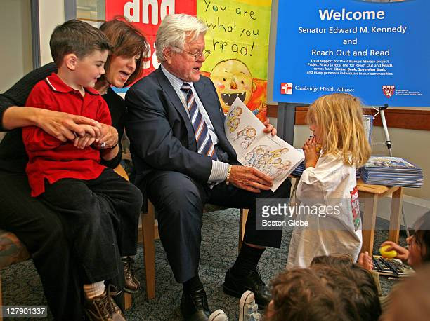 Accompanied by his wife Vicki Kennedy Sen Edward M Kennedy reads to children at the Cambridge Health Alliance's Somerville Pediatrics site on...