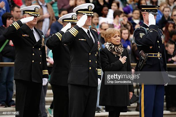 Accompanied by members of the US Navy SEALs Carmella LaSpada White House Special Projects Aide to President John F Kennedy participates in a wreath...