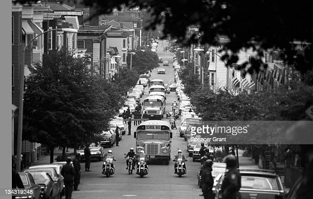 Accompanied by motorcyclemounted police school buses carrying African American students arrive at formerly allwhite South Boston High School on...