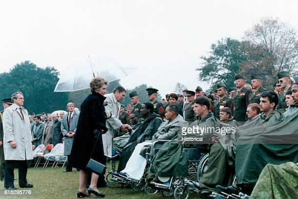 Accompanied by Nancy Reagan President Ronald Reagan meets with injured service men and women at a memorial service for Marines killed in Beirut The...