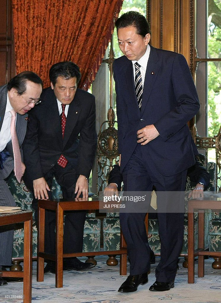 Accompanied by National Public Safety Committee Chair Hiroshi Nakai (L) and Foreign Minister Katsuya Okada (2L), Japanese Prime Minister Yukio Hatoyama (R) heads for a cabinet meeting at the national Diet in Tokyo on May 28, 2010. Japan and the United States agreed to keep a US military base on the island of Okinawa despite strong local opposition, resolving a row that has badly strained ties between the allies.