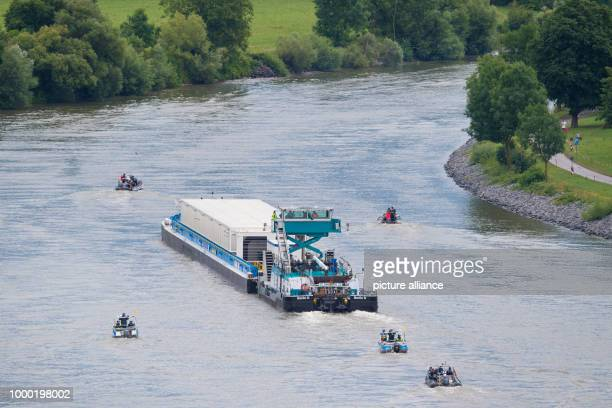 Accompanied by police boats the push boath 'Edda' pushes the transport ship loaded with three Castor containers on the Neckar river near Bad Wimpen...