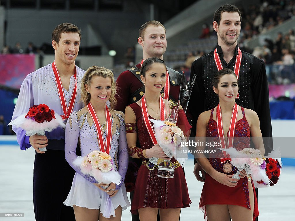 Accompanied by second-placed Canadian pair Kirsten Moore-Towers (front L) and Dylan Moscovitch (back L), and third-placed US pair Marissa Castelli (front R) and Simon Shnapir (top R), Russian pair Vera Bazarova (front C) and Yuri Larionov (back C) pose for photographers during the awards ceremony for the pairs event at the NHK Trophy, the last leg of the six-stage ISU figure skating Grand Prix series, in Rifu, northern Japan, on November 25, 2012. AFP PHOTO/Toru YAMANAKA