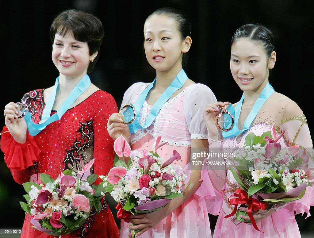 Accompanied by second-placed Irina Slutskaya of Russia and third-placed Yukari Nakano of Japan, Mao Asada of Japan shows her gold medal during an awarding ceremony for women's event in the figure skating Grand Prix series final in Tokyo, 17 December 2005. Fifteen-year-old Asada won the event. AFP PHOTO/Toru YAMANAKA