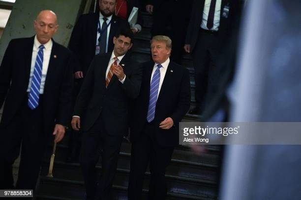 Accompanied by Speaker of the House Rep Paul Ryan US President Donald Trump arrives at a meeting with House Republicans at the US Capitol June 19...