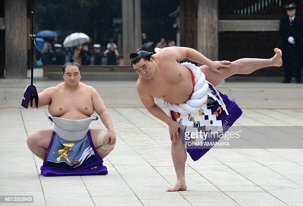 Accompanied by sumo wrestler Aminishiki Mongolianborn sumo grand champion or 'yokozuna' Harumafuji performs a ringentering ceremony at Meiji Shrine...