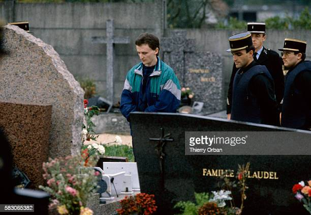 Accompanied by the police JeanMarie Villemin visits his son's grave in LepangessurVologne France His son Gregory Villemin was found murdered on...