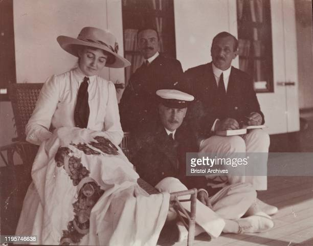 Accompanied by three men from the royal entourage, Princess Patricia, daughter of the Duke of Connaught, embroiders a tablecloth on the deck of the...