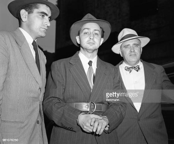 Accompanied by two deputy US Marshals Thomas Hasson and John J Gericke Harry Gold confessed atomic spy leaves New York's Federal Court for a jail...