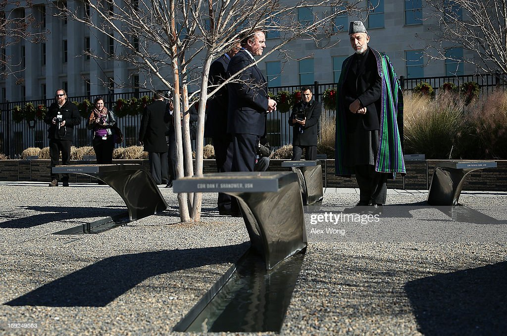 Accompanied by U.S. Secretary of Defense Leon Panetta (3rd R) and President of Pentagon Memorial Fund James Laychak (2nd R), Afghan President Hamid Karzai (R) visits the National 9/11 Pentagon Memorial January 10, 2013 in Arlington, Virginia. Karzai is on a visit in Washington, including a meeting with U.S. President Barack Obama at the White House, to discuss the continued transition in Afghanistan and the partnership between the two nations.