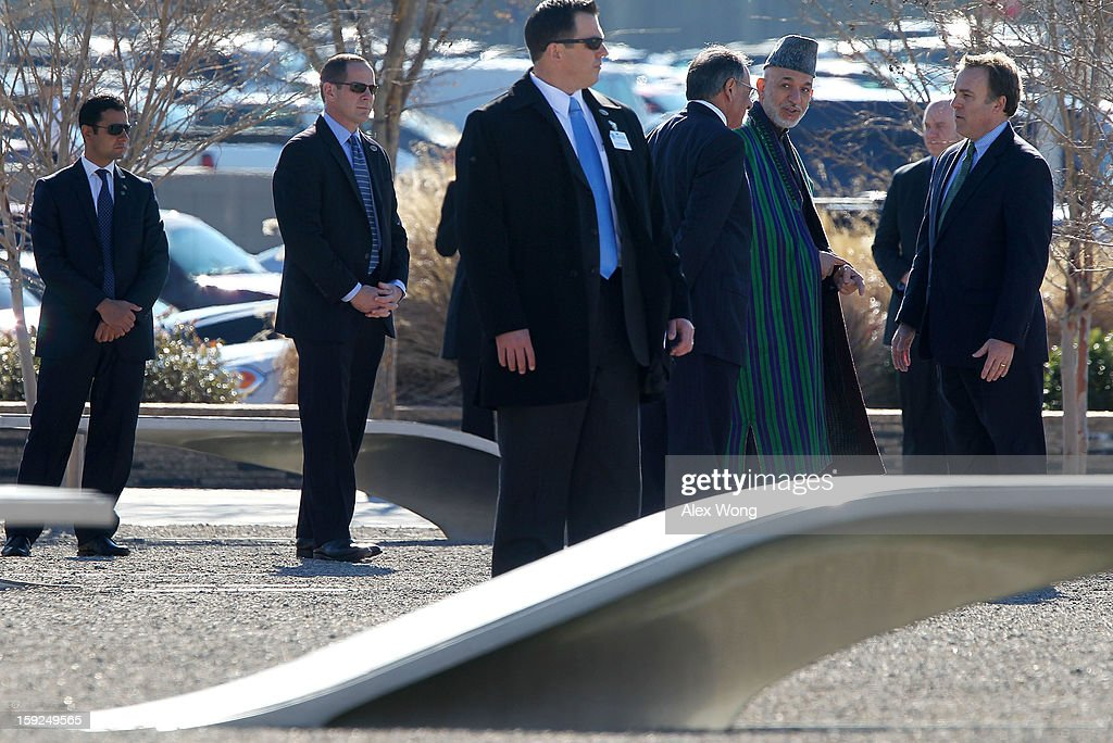 Accompanied by U.S. Secretary of Defense Leon Panetta (C and President of Pentagon Memorial Fund James Laychak (R), Afghan President Hamid Karzai (3rd R) visits the National 9/11 Pentagon Memorial January 10, 2013 in Arlington, Virginia. Karzai is on a visit in Washington, including a meeting with U.S. President Barack Obama at the White House, to discuss the continued transition in Afghanistan and the partnership between the two nations.