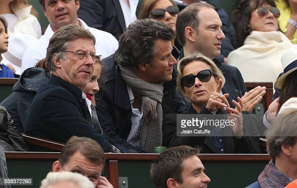 Accor CEO Sebastien Bazin AnneSophie Lapix and her husband Arthur Sadoun attend the Men's Singles final between Novak Djokovic of Serbia and Andy...