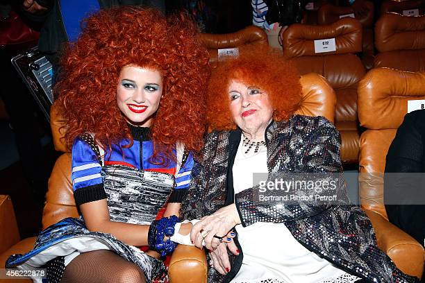Accordeonist Yvette Horner poses with a model after the last Jean Paul Gaultier Womenswear show as part of the Paris Fashion Week Womenswear...